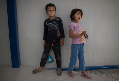 """The siblings Muhammed, 7 and Amina, 8, is waiting for the school to start in Suruc refugee camp, Turkey, April 25, 2016. Of the approximately 15 000 children who lives in the camp only 6 000 of them goes to school according to Unicef.  """"I want to be a doctor, because then your kind"""", says Muhammed.   """"I want to be a teacher, because that seems to be the funniest"""", says Amina."""