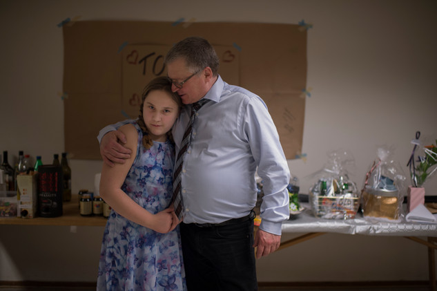 Hannah Liljekvist is hugging her sisters father in law on her sisters boyfriends birthday party.