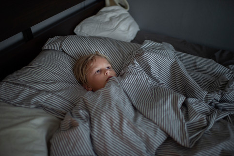 Viggo, 11, is resting in his mother Thereses bed.   Therese Storm, 36, is living with the diagnosis PMDS. For about two weeks every month her personality and behavior changes. She easily gets angry, frustrated and her anxiety makes her tired.