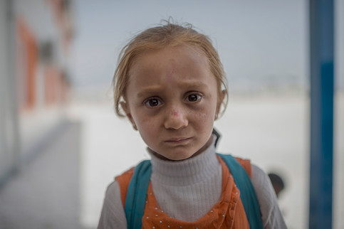 """Jihan, 6, is just arriving to school in Suruc refugee camp, Turkey, April 25, 2016. It's the largest refugee camp in Turkey. Of the approximately 15 000 children who lives there only 6 000 of them goes to school according to Unicef.  """"I would want to be a doctor when i grows up, because that is what my sister want to be""""."""