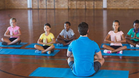 Kids meditating with coach