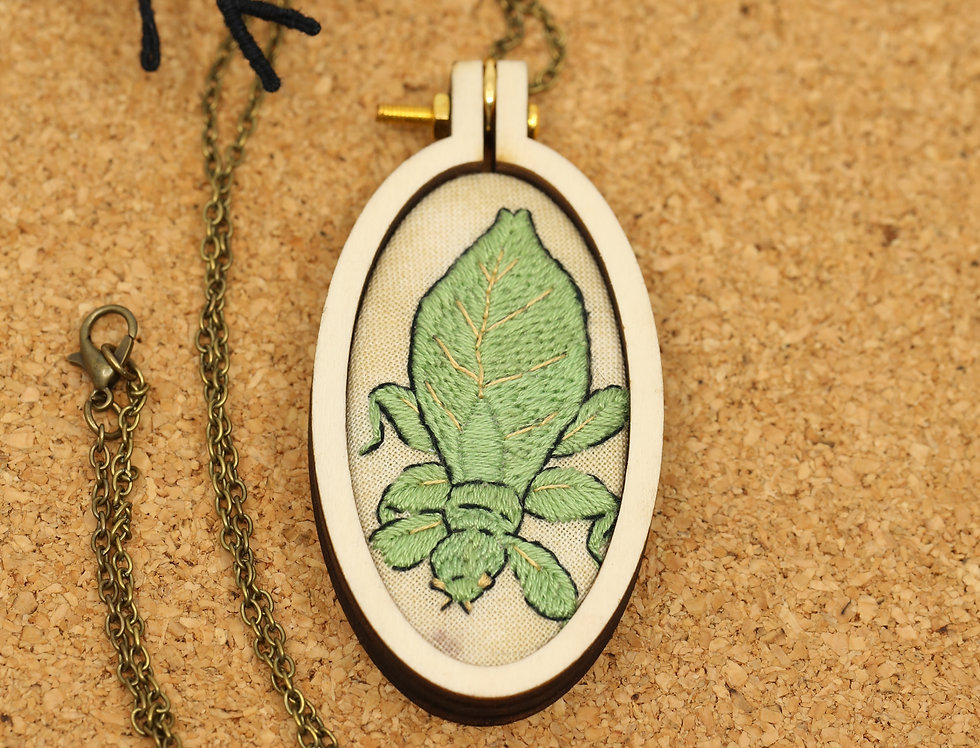 Leaf insect embroidered pendant