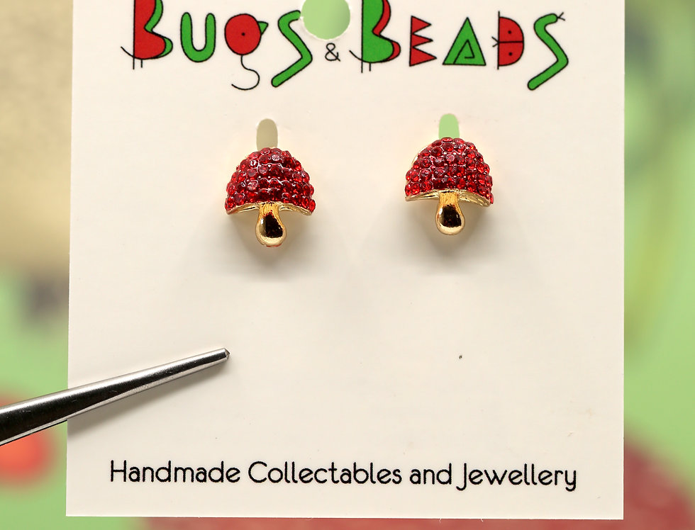 Red shiny mushroom stud earrings