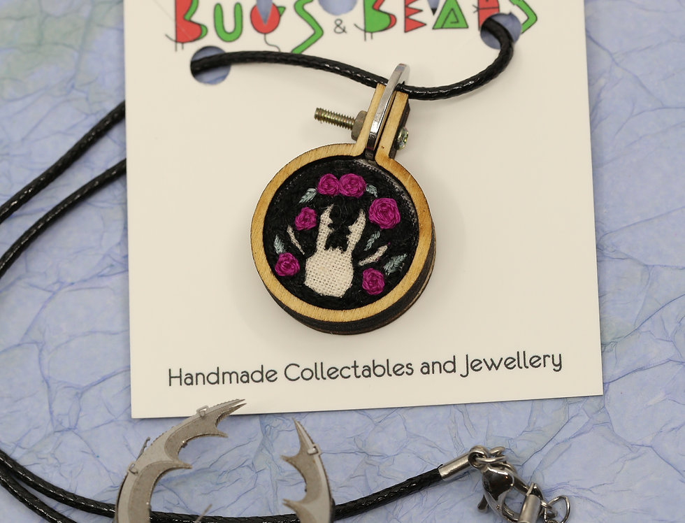 Stag Beetle silhouette hand embroidered pendant