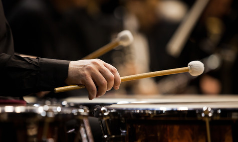 Hands musician playing the timpani in th