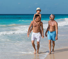 Three male generations walking by the sea