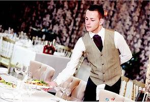 Server putting food on table