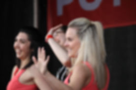 Dancers waving at IDFB