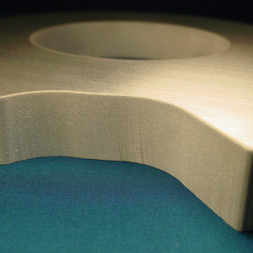 Accurate waterjet cutting of metal with accurate bevels.