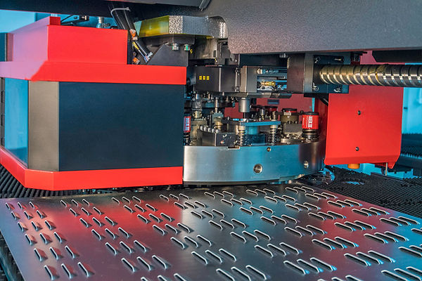 Amada punching machine, forming vents on sheet metal.