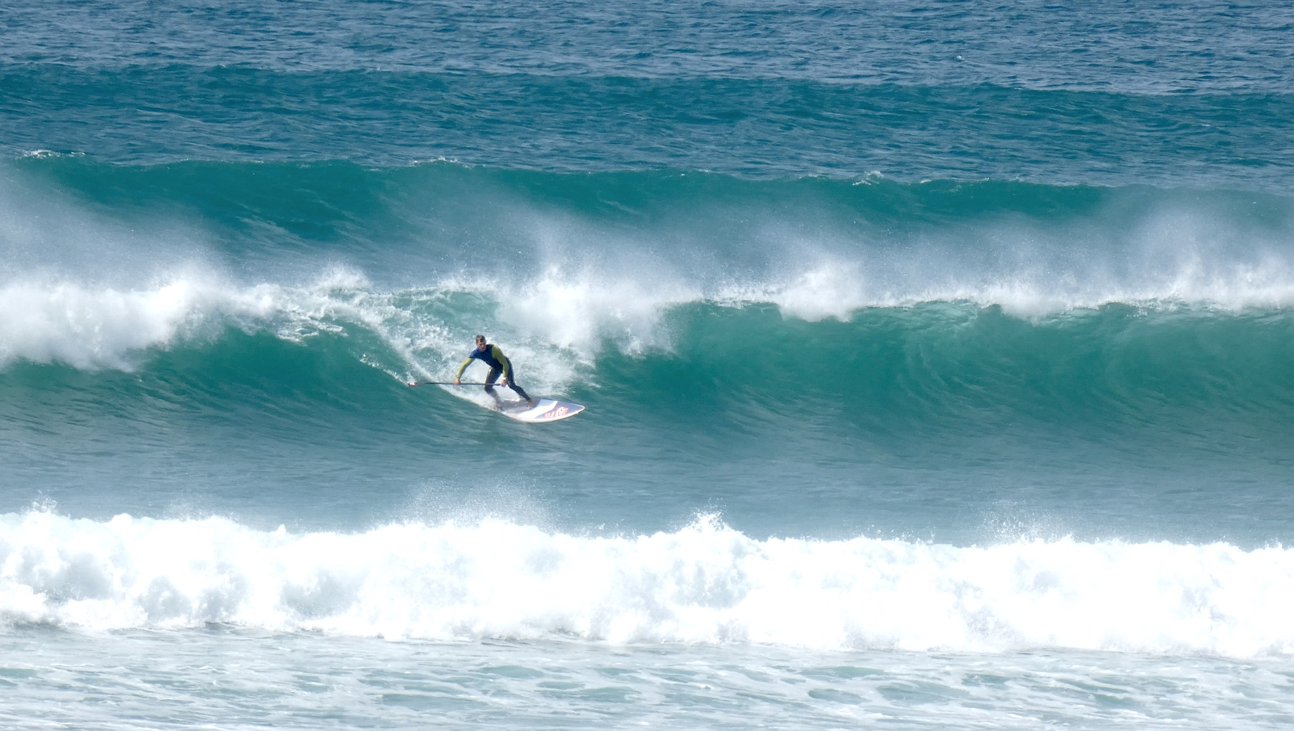 Sup surfing Gwithian, Cornwall