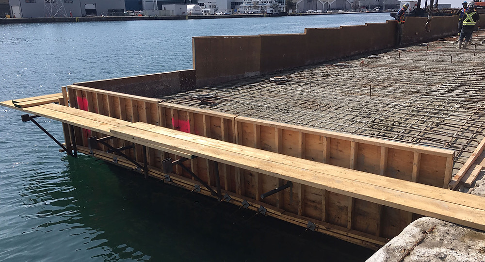 Wednesday, April 8:  concrete work in progress to restore a proper elevation of the dockwall.