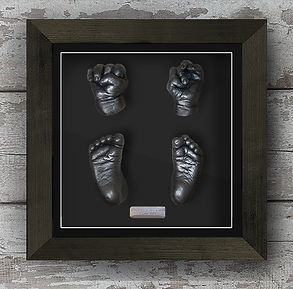 A full set of framed baby hand and foot keepsake casts