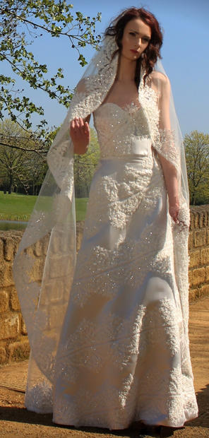 Sweep length, lace edged mantilla style veil