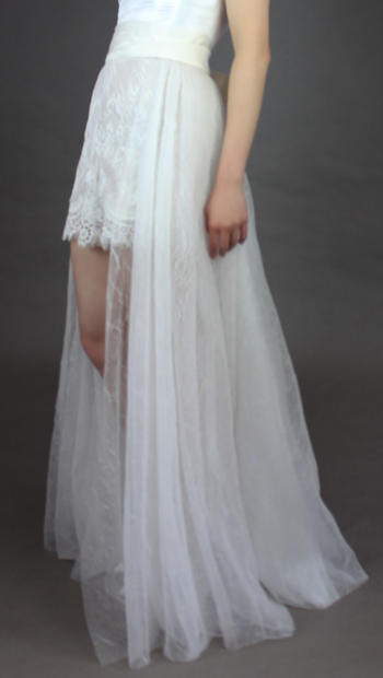 Cumberband style wrap with open front crinkle tulle over-skirt