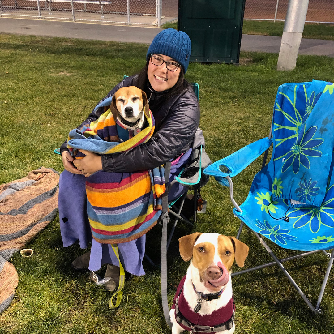 Robyn, Shiloh, and Lupin watch Fawkes' softball game in October