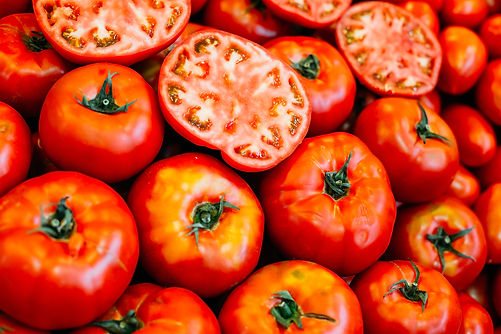 fresh-ripe-red-tomatoes-forming-backgrou