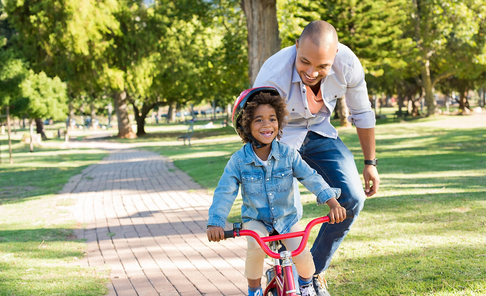 Kid Riding Bicyle With Father