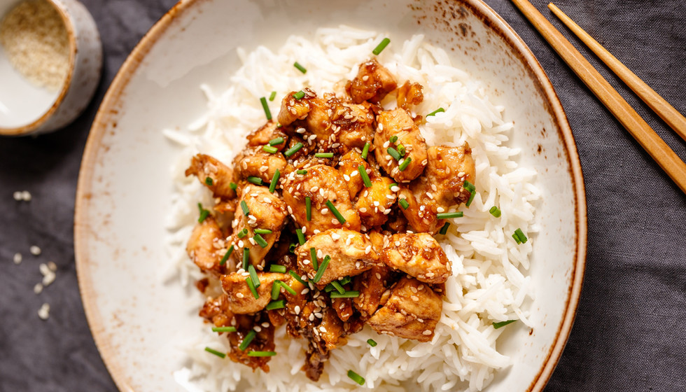 top-view-on-sesame-chicken-pieces-with-r