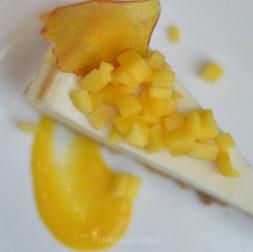 Cheesecake con Coulis de Mango