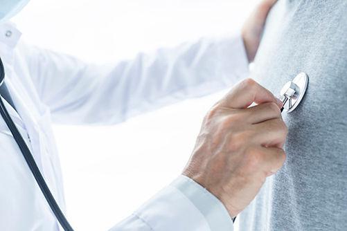 crop-doctor-examining-chest-patient_23-2