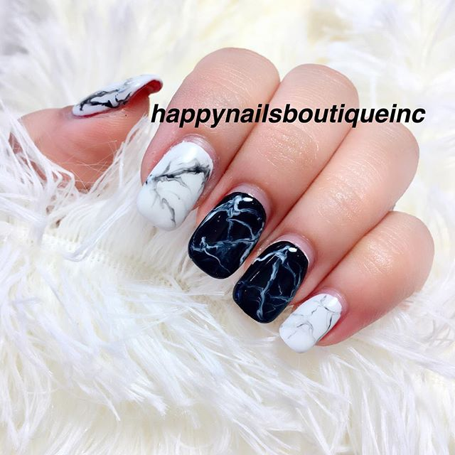 Keeping up with the newest trend_ hand painted marble nails.jpg