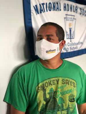 Community Safety Organizer Juan promoting safety with his GCHS mask!