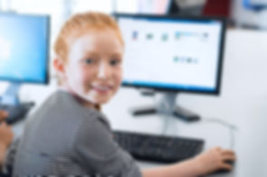 Young-girl-with-red-hair-on-computer-- B