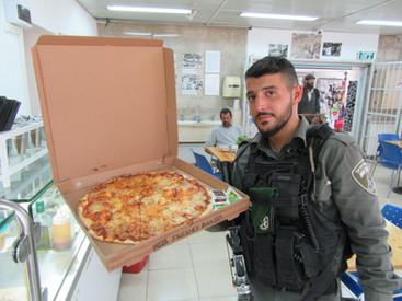 Magav enjoying Pizza in Hebron