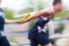 Motion blurred relay race at a track and