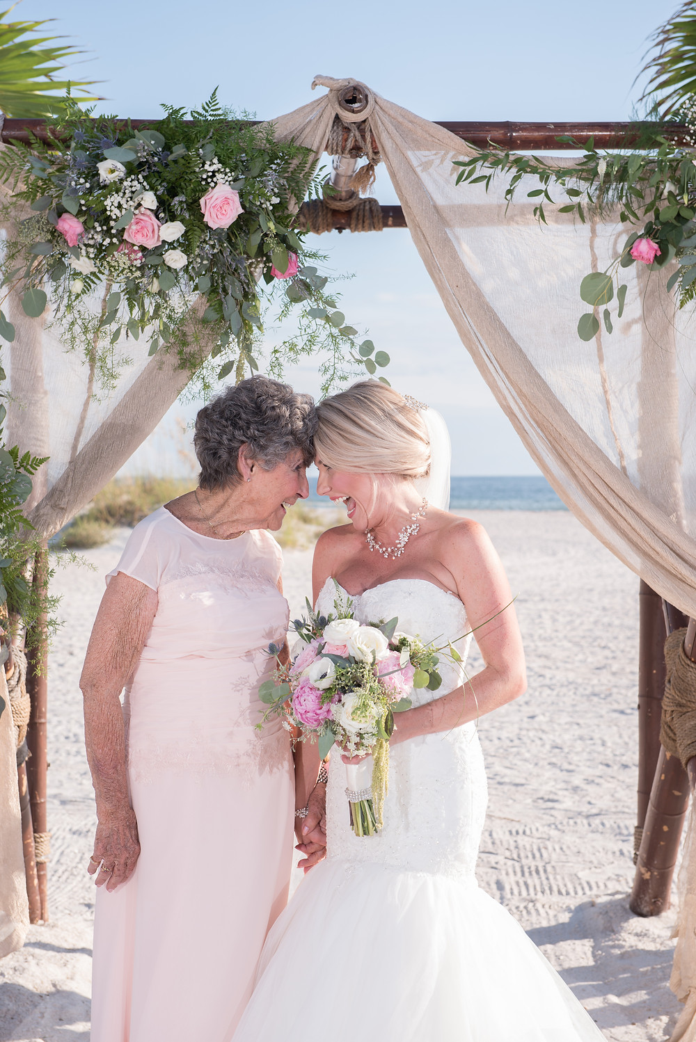 bride and grandmother share special moment on her wedding day