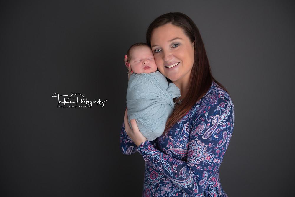 mother holding newborn baby son