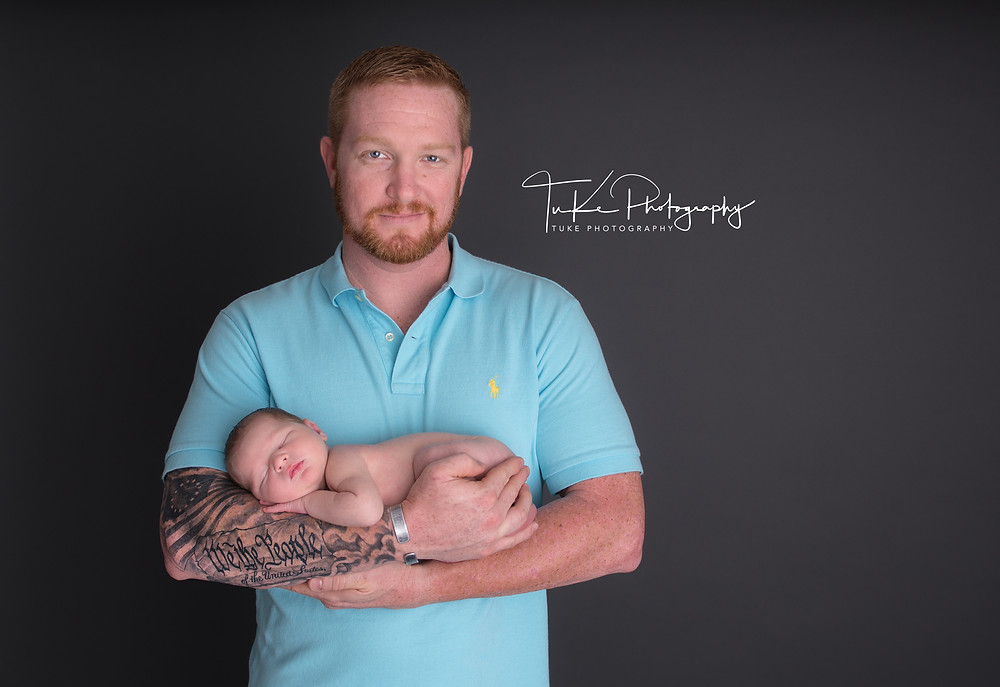 father holding newborn baby son