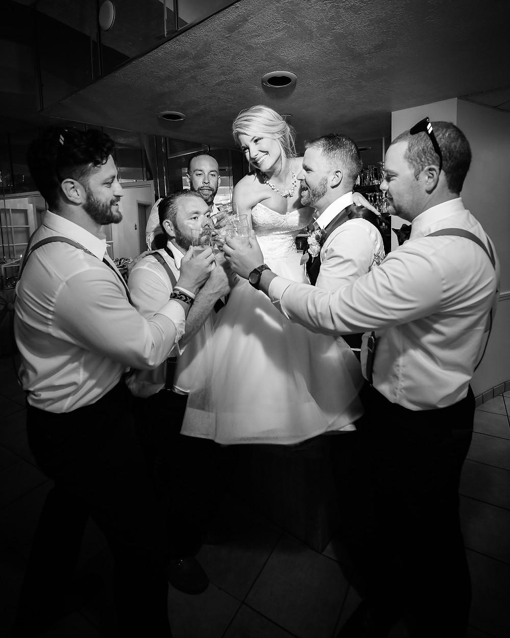 Groomsmen toast couple on their wedding day