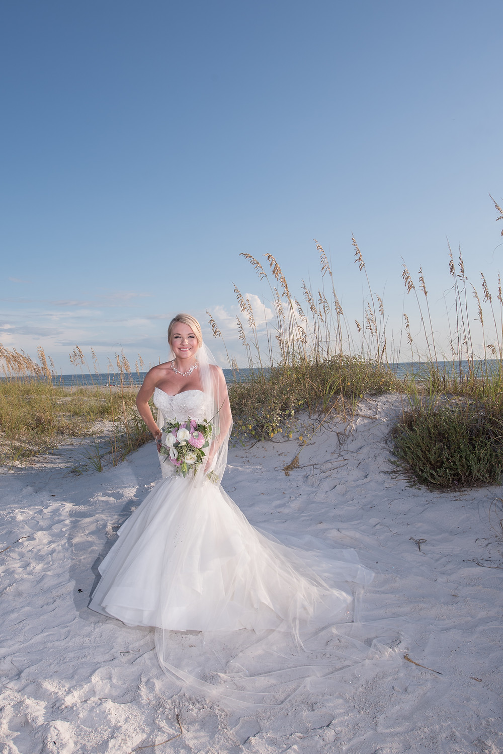 bridal portrait on dunes on St Pete Beach in Florida
