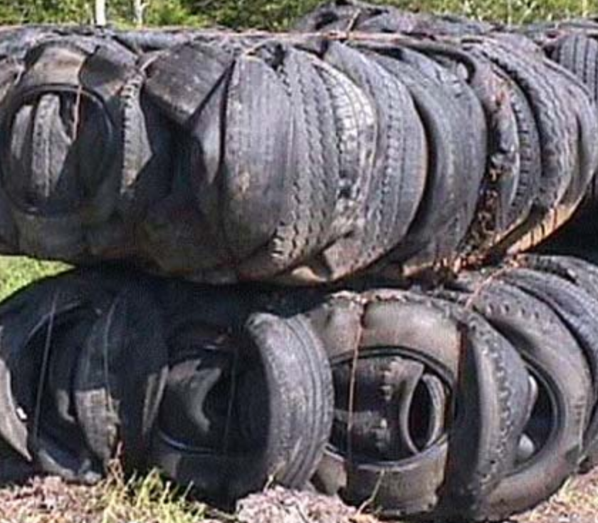 two tire bales (compressed tires with steel wire containing them)