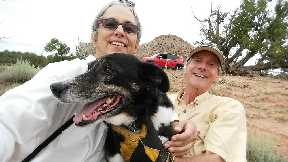 Kimi, Chip, and Ike smile for the camera while the jeep and mesa watch over them from the background.