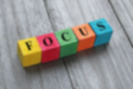 word focus on colorful wooden cubes.jpg