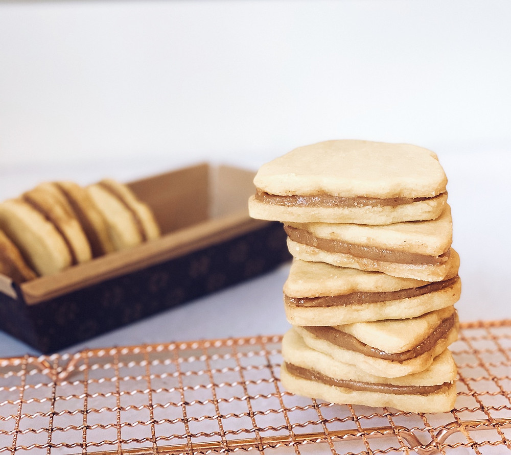 Vertically stacked cookies to show inside of walnut spread