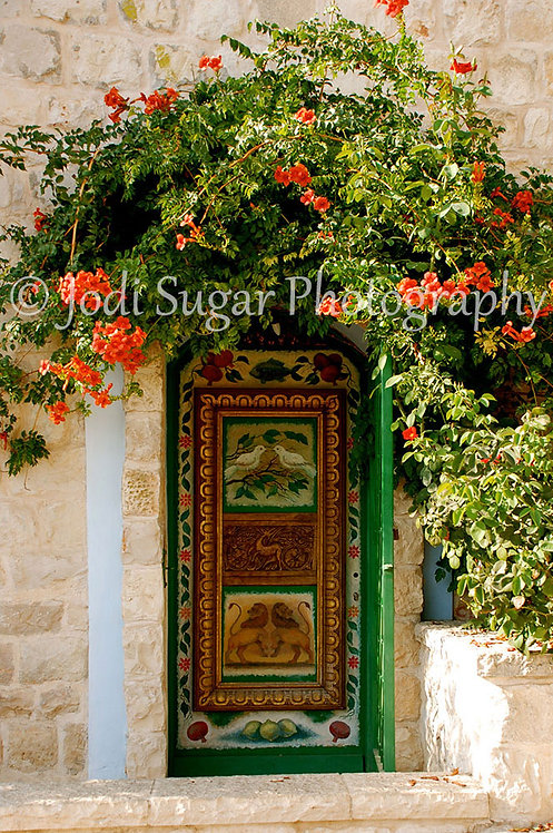 Green Door in Safed with Bougainvillea