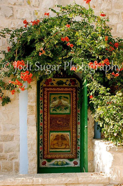 Green Door in Safed with Bougainvillea