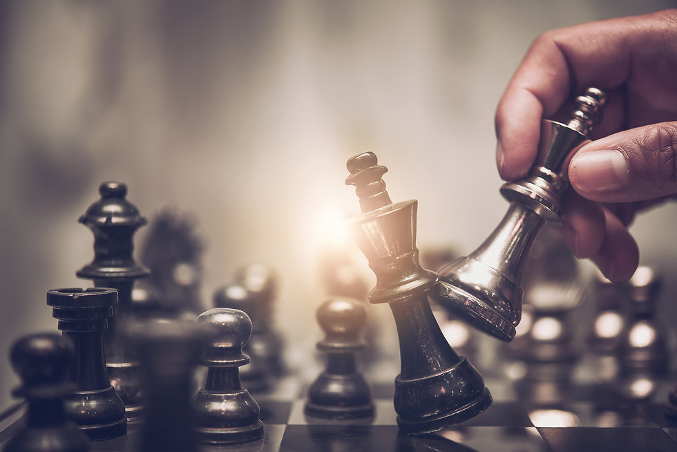 hand of businessman moving chess figure