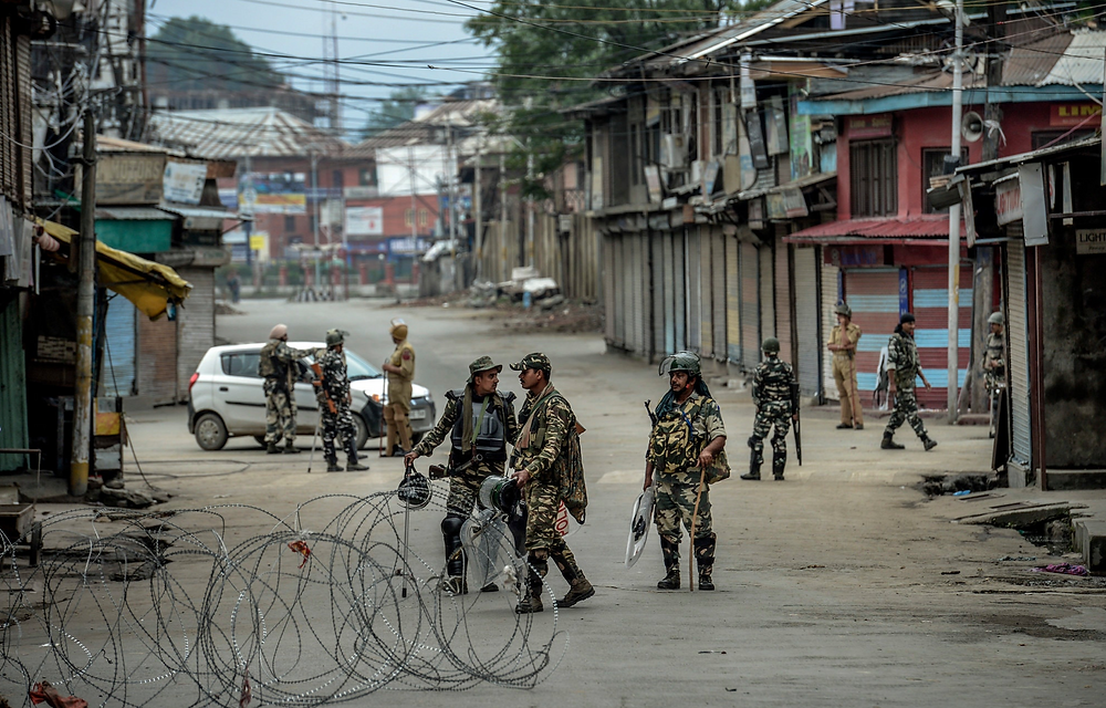 Indian security forces in Srinagar. The government has sealed off main roads, deployed surveillance helicopters and cleared side streets.