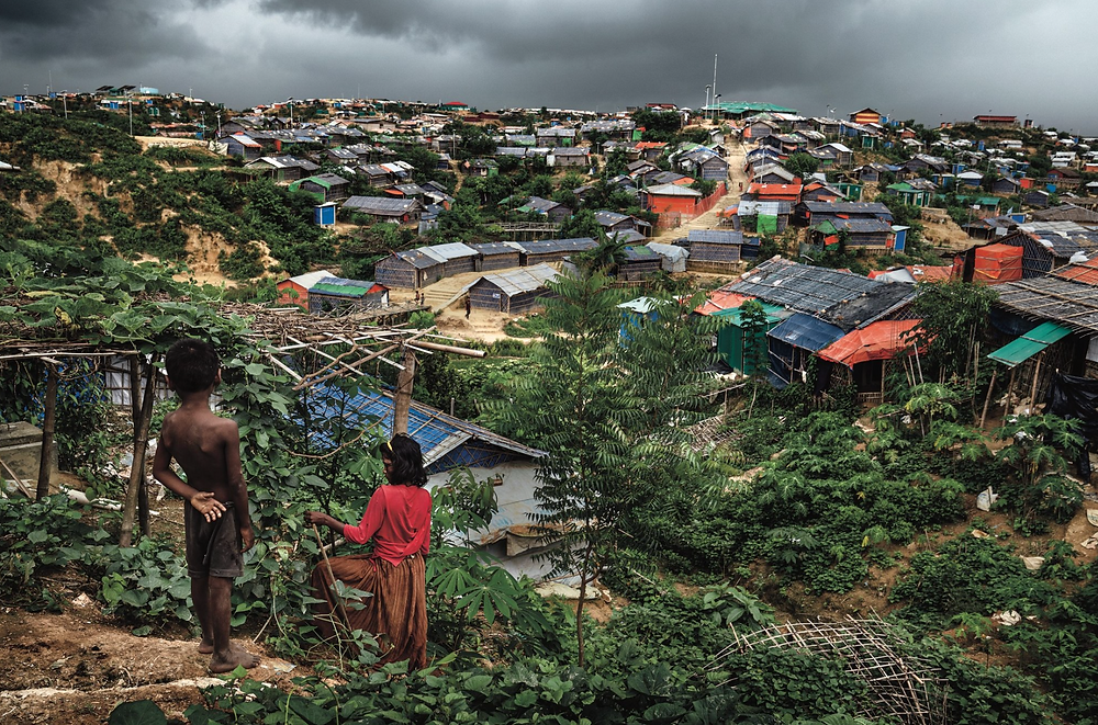 Rohingya refugees looking out across the Kutupalong Rohingya refugee camps.CreditAdam Dean for The New York Times