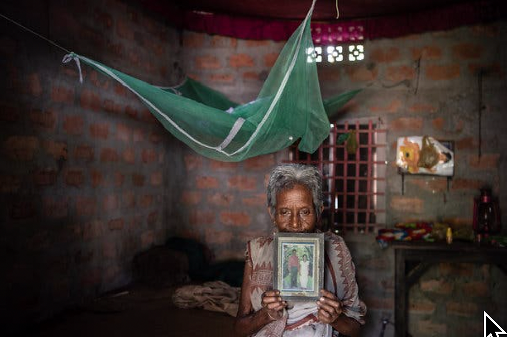 Beros Moni Das holds a photograph of her son Bhaben Das, who she said killed himself at age 50 after he was left off a registry of confirmed Indian citizens.Credit Saumya Khandelwal for The New York Times