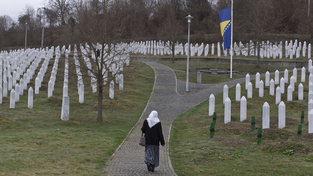 A woman walks through the cemetery in Potocari, Bosnia and Herzegovina, Wednesday, March 20, 2019 [Marko Drobnjakovic/AP]