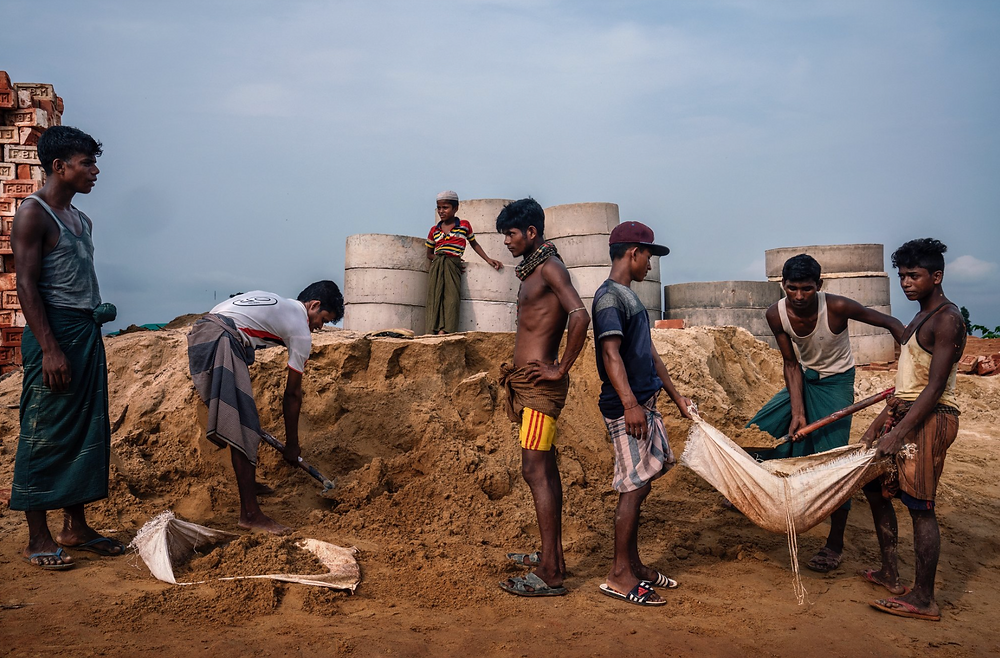 Rohingya refugees collecting sand to make concrete in the camps near Cox's Bazar, Bangladesh.CreditAdam Dean for The New York Times