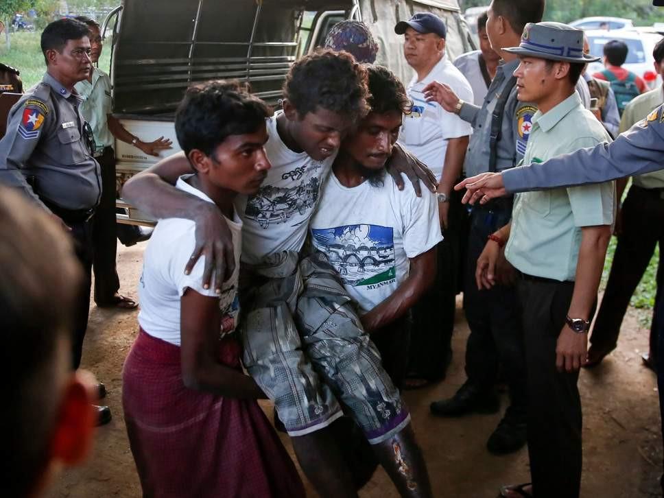 Injured Rohingya man among 106 people detained trying to flee Myanmar earlier this week ( EPA )