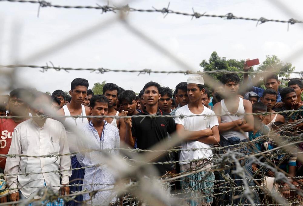 Rohingya refugees gather at the Bangladesh-Myanmar border on Aug. 24, 2018. (Nyein Chan Naing/EPA-EFE/REX/Shutterstock)