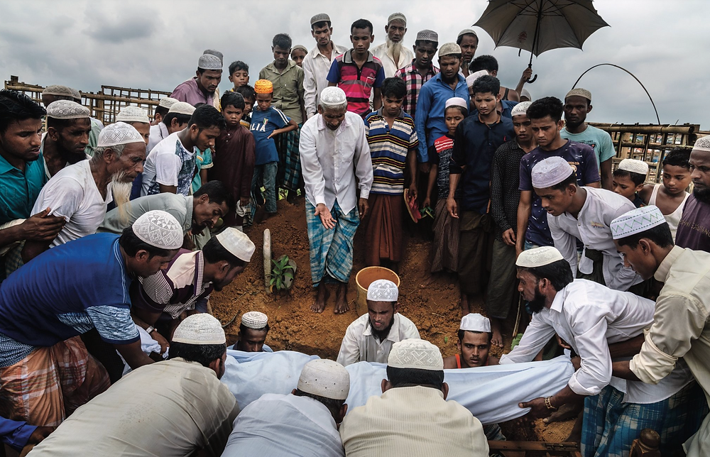 Rohingya refugees from Dunse Para burying a neighbor of Futhu's who died in the Bangladeshi camps. ''My father died, my grandfather died,'' Futhu said. ''Nothing has changed.''CreditAdam Dean for The New York Times